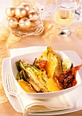 Chicory fried in herb butter with oranges and bacon