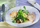 Salmon trout fillets with beer sauce and kohlrabi & lentils