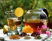 Iced herb tea with ingredients in open air
