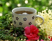 A cup of summer flower and herb tea