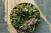 Herb wreath in a wooden bowl