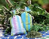 Two scented cushions with fresh and dried herbs