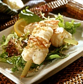 Barbecued monkfish on skewers