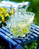 Grape punch in glasses on garden stool