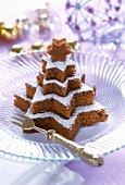 Fir tree shaped chocolate nut cake made from stars