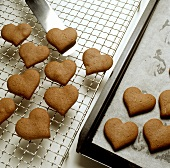 Cooling gingerbread hearts on cake rack