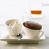 Gingerbread soufflé with rum cream