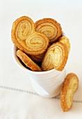 'Pig's ears' (puff pastries) in a beaker