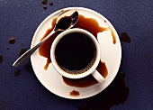 A cup of coffee, partly spilt