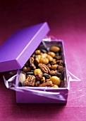 Roasted nuts with curry powder in gift box