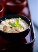 Coconut soup with chicken breast fillet, soya sprouts & basil