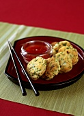 Prawn cakes with spicy sauce