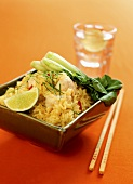 Curried rice with fish and pak choi