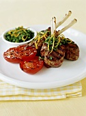 Grilled lamb cutlets and tomatoes with herbs