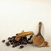 Coffee beans, cinnamon sticks and ground cinnamon