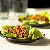 Seasoned minced beef on lettuce leaf