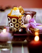 Yoghurt ice cream with mandarin oranges and cream topping
