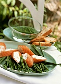 Salmon roulade with soft cheese filling on chives