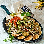 Warm aubergine and vegetable salad with sheep's cheese