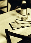 Menu with side plate, baguette and red wine