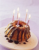 Gugelhupf with chocolate icing and candles