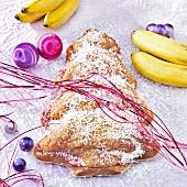 Banana and mango cake in shape of fir tree