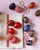 Coloured Easter eggs with elastic bands