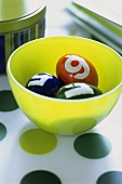 Easter eggs with numbers in a bowl