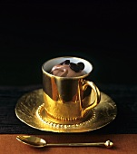 Coffee mousse in golden cup