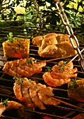 Barbecued shrimps kebabs and corncobs on barbecue
