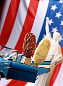 Light and dark almond ice cream on stick, toy Chevy, US flag