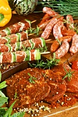Chipolata sausages, meat kebabs and spiced meat slices