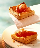 Peach slices in puff pastry squares