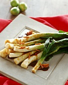 Poached leeks with sweet and sour sauce