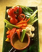 Bagna cauda (hot anchovy sauce with vegetable sticks, Italy)