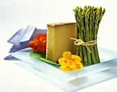 Still life with asparagus, cheese and nasturtium flowers