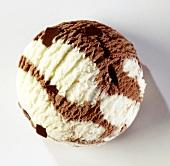 A scoop of vanilla and chocolate ice cream