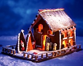 Gingerbread house with small marzipan figures