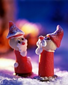 Two marzipan Father Christmases