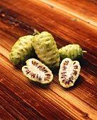 Noni on wooden background