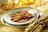 Coq au vin (chicken in wine sauce) with vegetable strudel