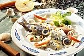 Matje herrings with spicy cream sauce
