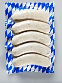 White sausages in blue & white plastic packaging (Bavaria)