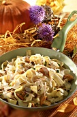 Pan-cooked pasta dish with chanterelles & cheese, autumn décor