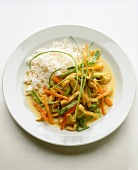 Chicken & vegetables cooked in wok with coconut sauce & rice