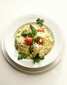 Asparagus risotto with green asparagus and cherry tomatoes