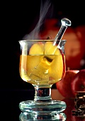 Steaming apple punch in glass