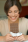 Woman holding a bar of chocolate (grainy effect)