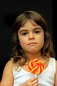 Small girl with coloured lollipop (grainy effect)