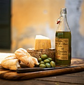Still life with bread, Parmesan, olives and olive oil